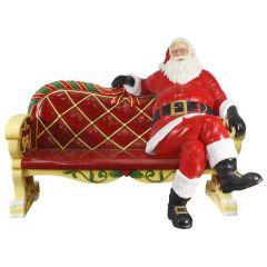 Santa Sitting On A Bench